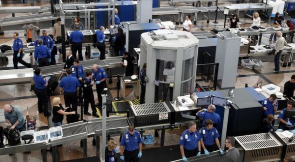 TSA workers carry out security checks at Denver International Airport, the day before the Thanksgiving holiday in Denver